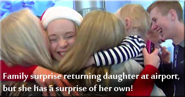Irish woman surprised by family at Dublin Airport... and she has a surprise of her own