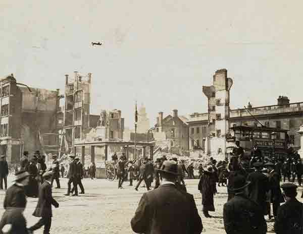 Abbey Street immediately after the fall of the corner house following the Easter Rising