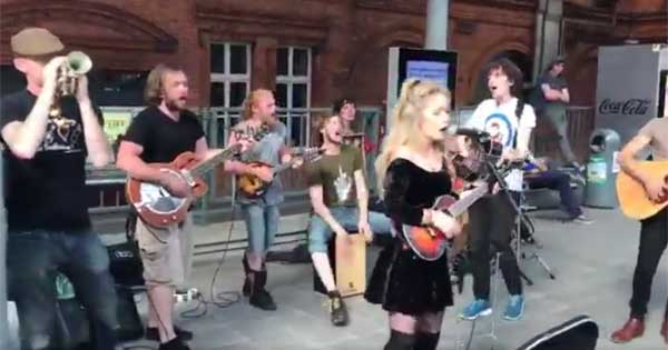 Irish band cheer up delayed passengers as they wait for their train