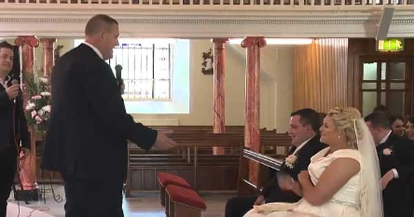 Father serenades his daughter during her wedding