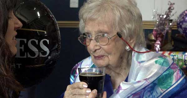 100 year-old woman thanks a pint of Guinness a day