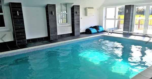 thatched cottage pool
