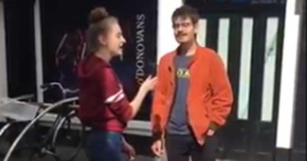 Young busker performs beautiful duet with 'random guy'