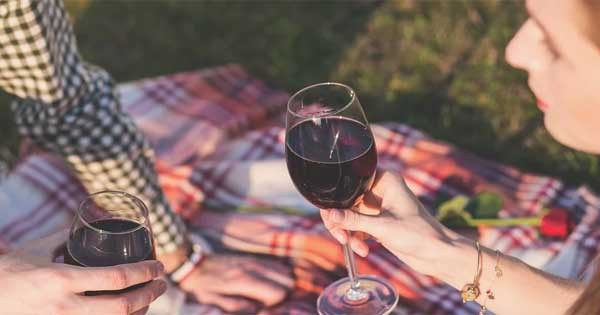 A glass of red wine could be as beneficial as a session at the gym