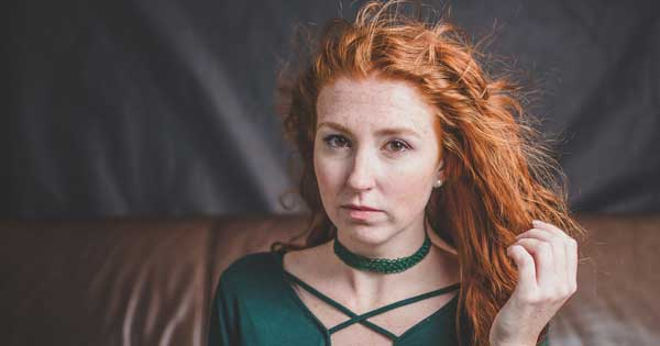 Bridesmaid asked to dye red hair so she won't 'destroy the wedding photos'
