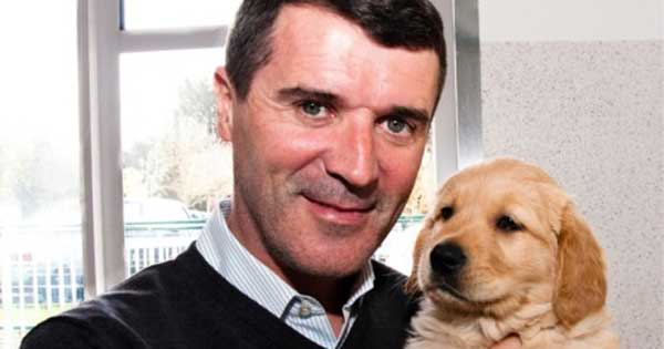 Roy Keane with a pup in training for Irish Guide Dogs for the Blind