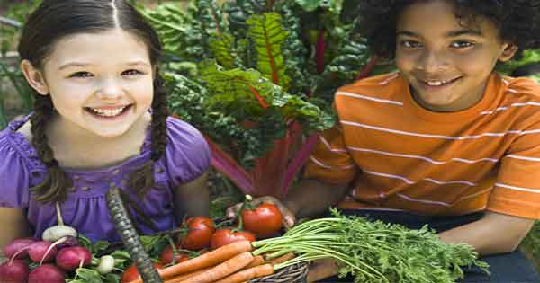 Children with fruit and veg
